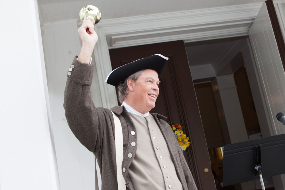 Tom Gahan calls everyone to attention during Saturday's celebrations in Mattituck. (Credit: Katharine Schroeder)