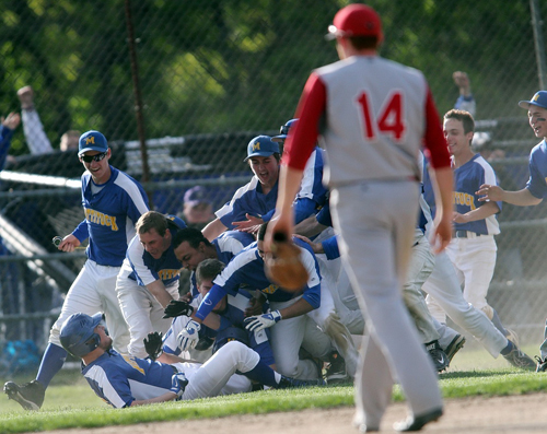 Mattituck players formed a jubilant dog pile after Chris Dwyer's walk-off hit capped a five-run rally in the seventh inning to defeat Center Moriches. (Credit: Garret Meade)