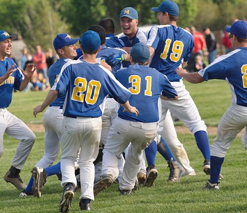 The Mattituck Tuckers meet on the infield grass for a postgame celebration after the team sealed its fourth county championship in 12 years. (Credit: Garret Meade)