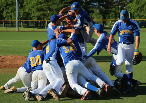 Mattituck players celebrating the team's second Long Island championship in four years following their 9-2 win over Wheatley. (Credit: Daniel De Mato)