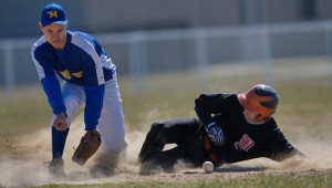 GARRET MEADE PHOTO | Babylon's Nick Giampietro advancing a base while Mattituck's Austin Pase looks for the ball.