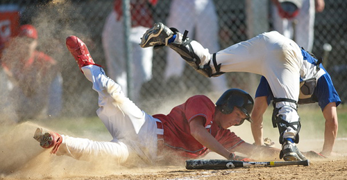 GARRET MEADE PHOTO | Sean Finnegan of Center Moriches upended Mattituck catcher Brian Pelan, but was thrown out at home plate by first baseman Ian Nish on a fielder's choice in the fifth inning.