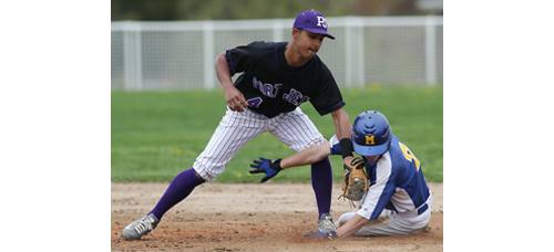 Joe Tardif's penchant for stealing bases is tough on his pants. Port Jefferson/Knox shortstop Andy Vasquez could not prevent the Mattituck sophomore from bagging one of his three steals on Friday.