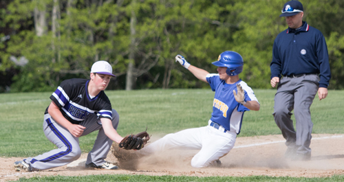 Mattituck's Joe Tardif sliding into third base during Game 1 of the Tuckers' semifinal series against Port Jefferson. (Credit: Katharine Schroeder)