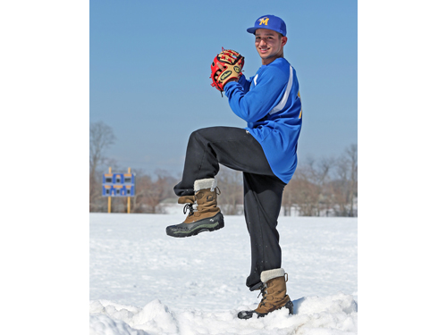 Marcos Perivolaris was perched atop a pile of snow, not a pitcher's mound, during Monday's practice. (Credit: Daniel De Mato)