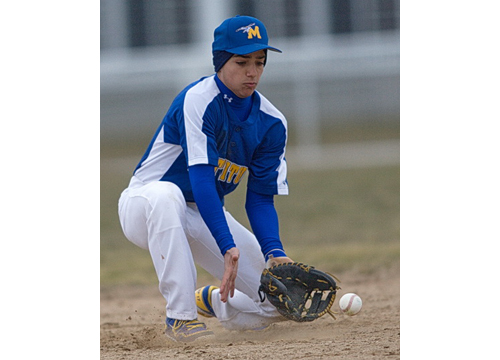 GARRET MEADE PHOTO | Mattituck shortstop Marcos Perivolaris used his glove as well as his bat to help the Tuckers win their league opener.