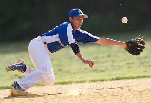 GARRET MEADE PHOTO | Mattituck shortstop Marcos Perivolaris can't reach Port Jefferson's first hit of the game, a single bounced up the middle by Joe Booker in the third inning.