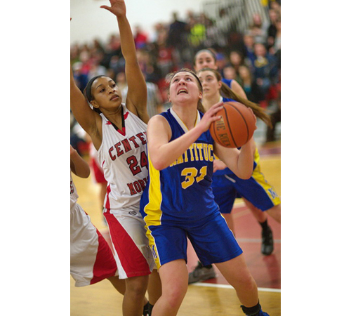 GARRET MEADE PHOTO | Allie Wilcenski, who led Mattituck with 19 points and 13 rebounds, looking for a shooting opening while Center Moriches' Vanessa Lewis guarded her.