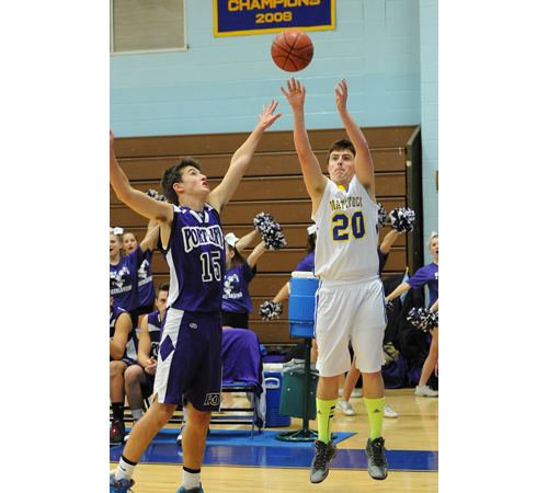 ROBERT O'ROURK PHOTO | Chris Dwyer of Mattituck sinking a 3-point shot as Port Jefferson's Cameron Harvey defends. Dwyer scored a career-high 21 points.
