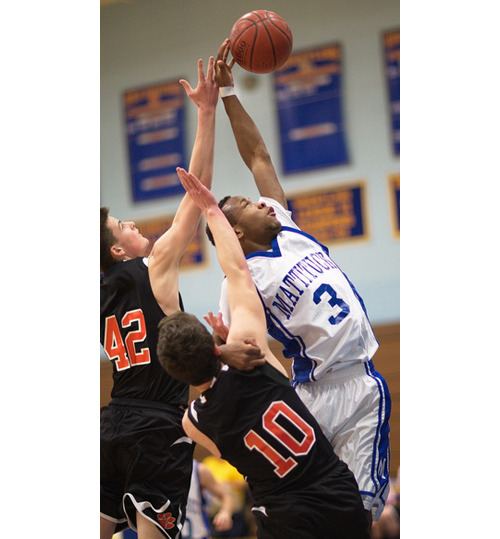 GARRET MEADE PHOTO | Mattituck's Eugene Allen reaching for a rebound in the vicinity of Babylon's Raymond Wardell (42) and Alec Zamet (10).