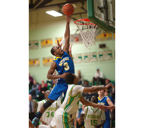 GARRET MEADE PHOTO | Mattituck's Gene Allen rises above the rim for an attempt at the basket during his team's loss to Wyandanch in an outbracket game on Tuesday evening.