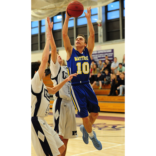 ROBERT O'ROURK PHOTO | Joe Tardif of Mattituck facing some opposition from Port Jefferson as he drives toward the basket during Friday's game.