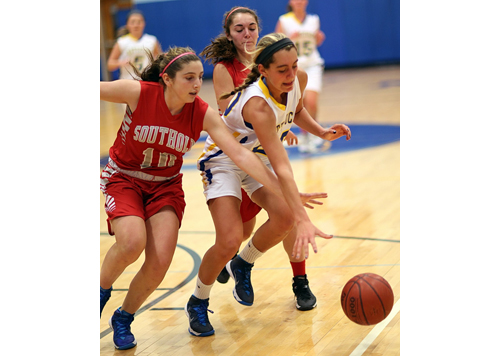 Southold/Greenport's Grace Syron (10) and Toni Esposito pursue the ball along with Mattituck's Katie Hoeg. (Credit: Garret Meade)