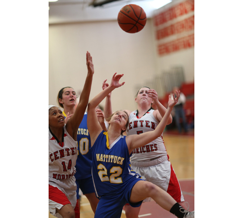 From left, Center Moriches' Tania Rowland, Mattituck's Katie Hoeg and Lisa Angell and Center Moriches' Caroline Casey reach for a rebound. (Credit: Garret Meade)