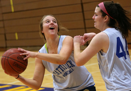 Mattituck's only two seniors, Lisa Angell, left, and Courtney Murphy, during Thursday's practice. (Credit: Garret Meade)