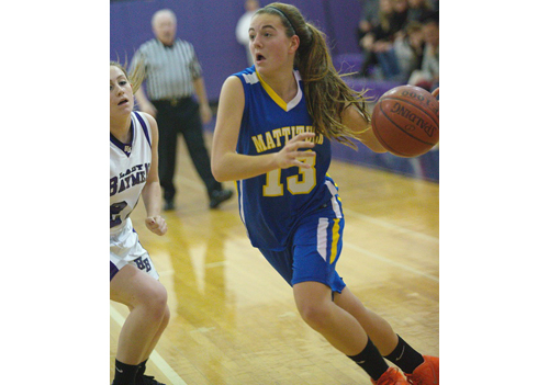GARRET MEADE PHOTO   Mattituck's Liz Dwyer dribbling into the paint during Monday night's game in Hampton Bays. The Tuckers were outrebounded by 42-21 and whistled for 21 fouls.