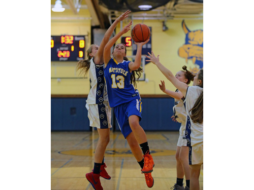 DANIEL DE MATO PHOTO | Shoreham-Wading River's Courtney Clasen was unable to block this shot by Mattituck's Liz Dwyer in the first quarter, but Clasen finished with the game with 9 blocks.