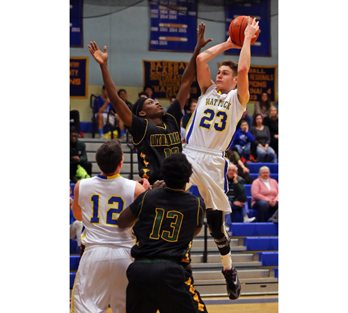 Ryan Mowdy #23 sinks a jump shot over Tyler Damas #12 of Wyandanch. Mattituck lost to Wyandanch 84-71 at Mattituck High School on Jan. 29, 2016.