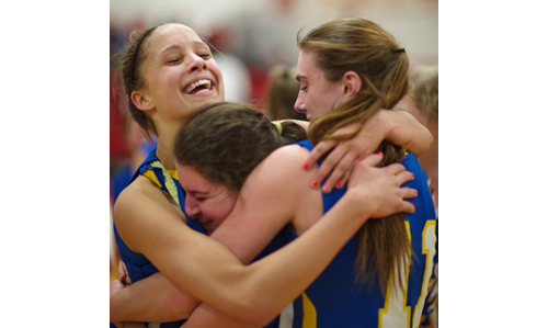 From left, Tiana Baker, Christine Bieber and Shannon Dwyer embrace each other following Mattituck's county semifinal victory over Center Moriches. (Garret Meade photo)
