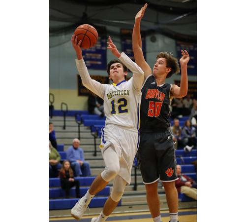 Mattituck's Tyler Seifert #12 goes up for a layup past Gregg Forstner #50 during Mattitucks 58-52 loss to Babylon at Mattituck High School, Mattituck on Feb 11th, 2017