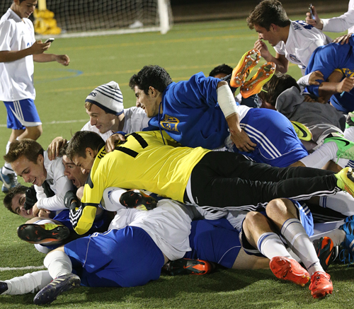 Mattituck players celebrate a playoff win over Rye Neck on their way to winning the New York State Class B championship. (Credit: Garret Meade, file)