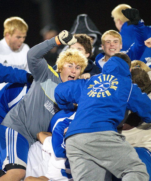 GARRET MEADE FILE PHOTO | Mattituck goalkeeper Steve Ostrowski and his teammates celebrating following their 5-4 victory over Spackenkill in a Southeast Region final.