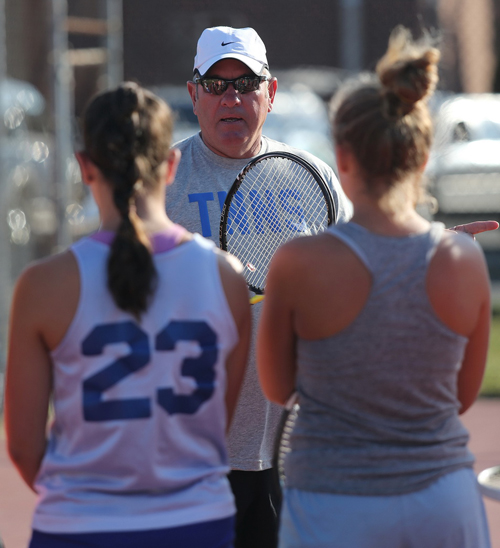 Mattituck's new girls tennis coach, Mike Huey, talks to his players during a recent practice. (Credit: Garret Meade)