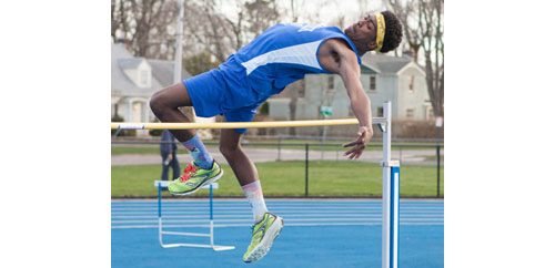 Mattituck junior Darius Brew took first place in the high jump with a height of 6 feet during Thursday's dual meet against Wyandanch. (Credit: Katharine Schroeder)