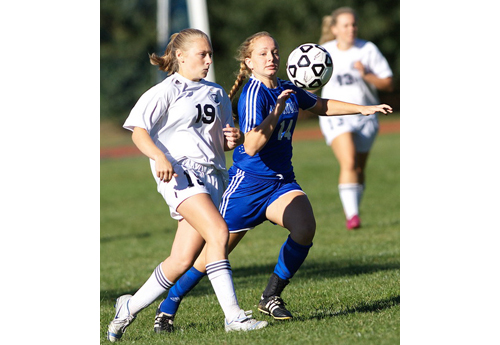 GARRET MEADE PHOTO | Stony Brook's Sydney Dunn, left, and Mattituck's Abby Graeb trying to gain control of the ball.