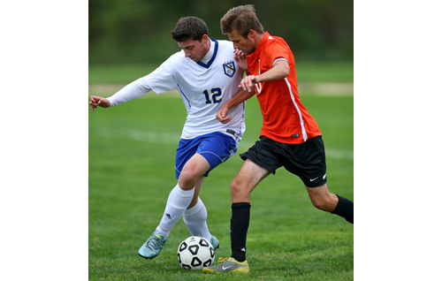 Mattituck's Dan Fedun, left, and Babylon's Michael Herbst battling for the ball during Thursday's game. (Credit: Garret Meade)