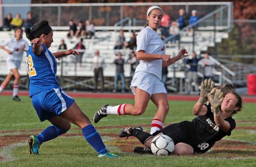 Mattituck's Elvira Puluc tries to get a foot on the ball, only to be thwarted by Center Moriches goalkeeper Megan Ricci. (Credit: Daniel De Mato)