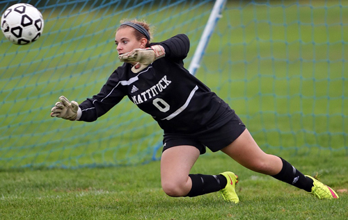 Mattituck goalkeeper Emma Fasolino stretches for a Port Jefferson shot that missed the mark in the first half. (Credit: Garret Meade)