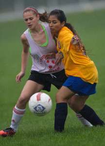 GARRET MEADE PHOTO | Center Moriches' Emily Fey, left, and Mattituck's Jasmine Fell have their eyes on the same prize.