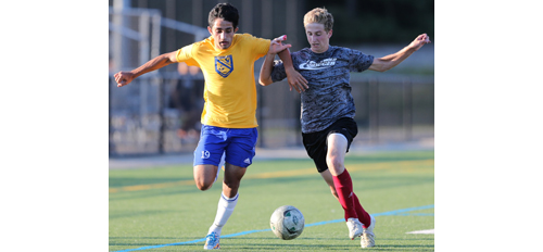 Mattituck's Kaan Ilgin, left, fights for possession of the ball with Southold's Shayne Johnson. (Credit: Daniel De Mato)