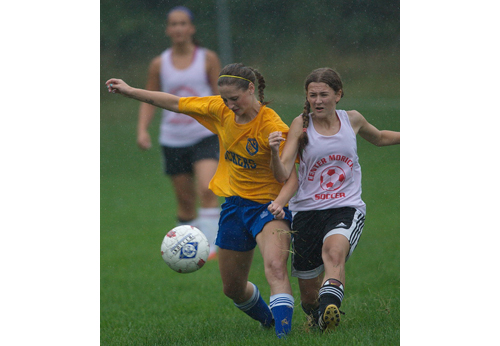 GARRET MEADE PHOTO | Mattituck sweeper Nicole Zurawski, left, battling with Casey Luongo of Center Moriches for possession of the ball.