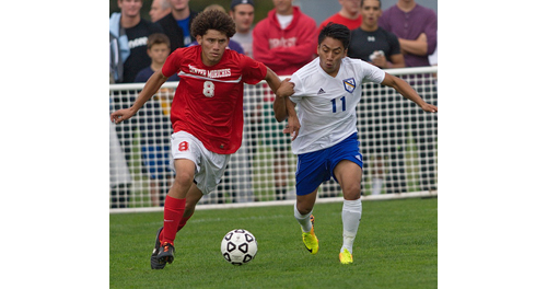 GARRET MEADE PHOTO | Mattituck's Oscar Puluc, right, tracking down Center Moriches' Josue Lazo-Molina.