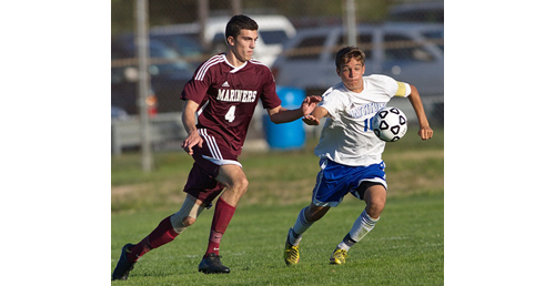 GARRET MEADE PHOTO | Southampton's Elliot LaGuardia and Mattituck's Paul Hayes in pursuit of the ball.