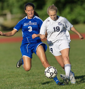 GARRET MEADE PHOTO | Sydney Dunn of Stony Brook gets a foot on the ball before Mattituck's Trish Brisotti can.