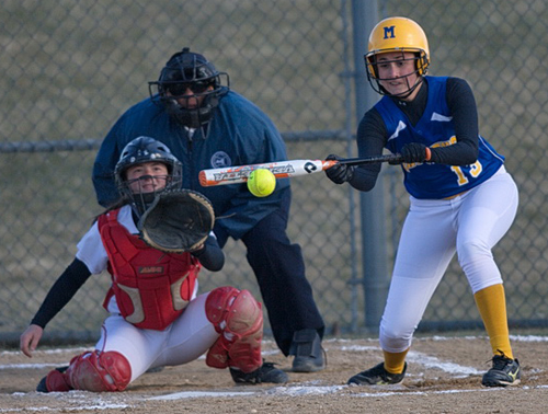 GARRET MEADE PHOTO | Mattituck's Alexa Orlando laying down a bunt before the ball could reach Center Moriches catcher Megan Ricci.
