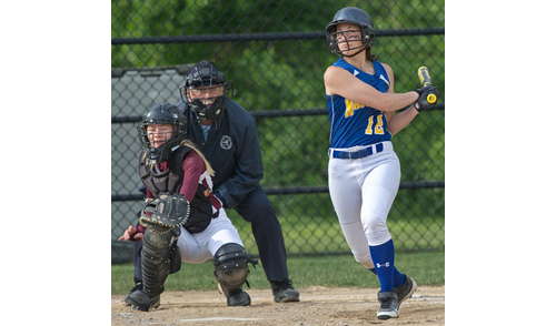 GARRET MEADE PHOTO | Mattituck's Melissa Siegfried follows the path of her drive to center field. Mattituck bats produced 12 hits against Southampton.