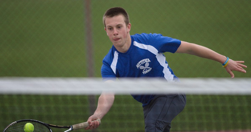 GARRET MEADE PHOTO | Mattituck's third singles player, Andrew Young, returning a shot against Longwood's Taylor Fichtnez.