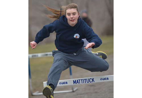 GARRET MEADE FILE PHOTO | Shannon Dwyer, a pentathlon veteran, working on her hurdling during Mattituck's practice last March.