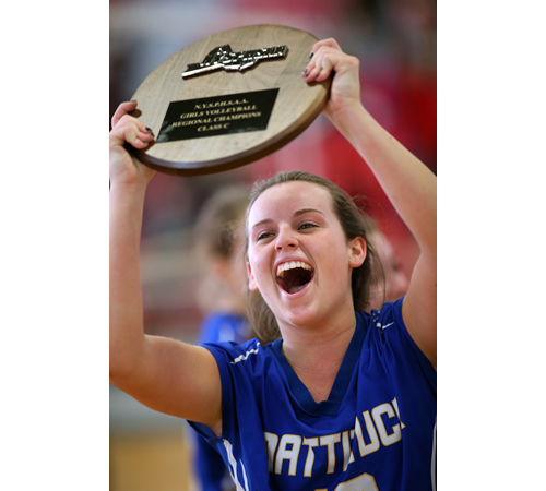 Senior libero Carly Doorhy raises the Long Island Class C championship plaque, Mattituck's fifth in six years. (Credit: Garret Meade)