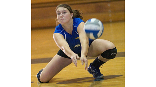 GARRET MEADE PHOTO | Mattituck outside hitter Emilie Reimer hit the floor to pop up a hit by Elwood/John Glenn.