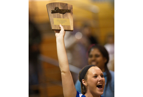 GARRET MEADE PHOTO | One of Mattituck's captains, Laurel Bertolas, holding up the third Long Island championship plaque the Tuckers have won in four years.