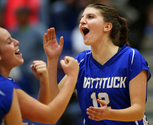 Mattituck's Carly Doorhy, left, and Skyler Grathwohl rejoice following their team's county semfiinal win over Greenport/Southold. (Credit: Garret Meade)