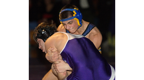 GARRET MEADE PHOTO | Mattituck/Greenport's Christian Angelson, facing the camera, defeated Port Jefferson's Martin Genao.