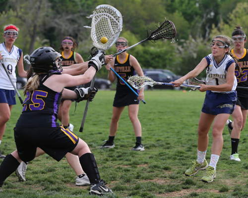DANIEL DE MATO PHOTO | Mattituck/Greenport/Southold's Audrey Hoeg taking a shot against Sayville goalie Molly Andrews.