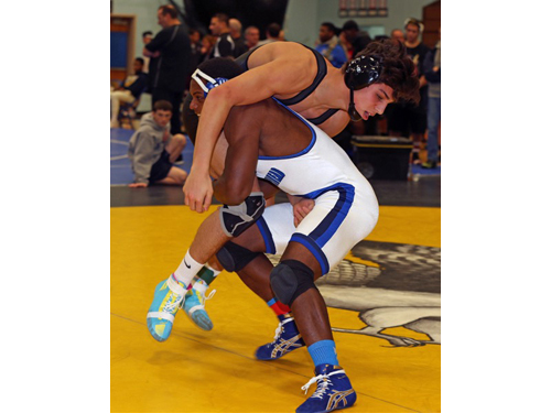 Mattituck/Greenport/Southold's Tanner Zagarino, right, wrestling against Riverhead's Raheem Brown, won the 170-pound title and was selected the North Fork Invitational's Champion of Champions. (Credit: Garret Meade)