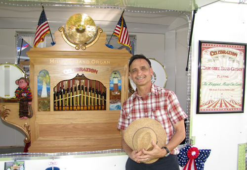 TIM GANNON PHOTO | Michael Sarlo and his organ, Celebration, at the Greenport Carousel in Mitchell Park Saturday.